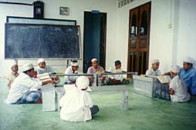 Menghafaz Al-Quran di bawah bimbingan guru